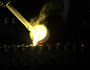 molten bronze being poured into molds