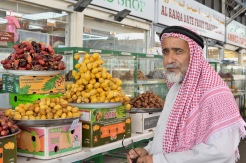 Emirati gentleman perusing the dates.